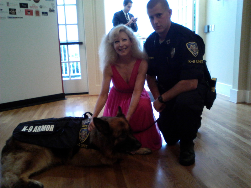 K-9 Armor Co-founder Suzanne Saunders and ESA K-9 Unit Handler Andy Greiner and K9 Wolfie.
