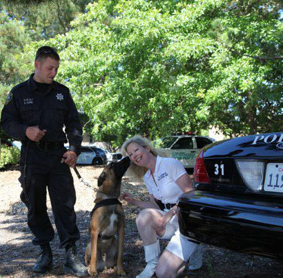 Richmond PD Officer Caine with K9 Ranger thanking Suzanne Saunders, K9 Armor Co-founder