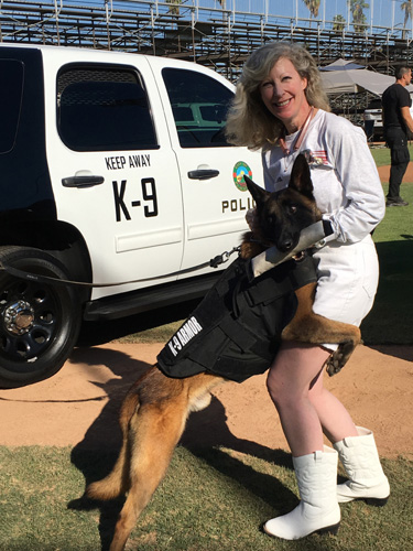Placentia PD K9 Ace gave hugs to K9 Armor cofounder Suzanne Saunders at the 2016 OCPCA K9 Benefit Show. Photos by Placentia K9 Assoc. Christina Marbrey