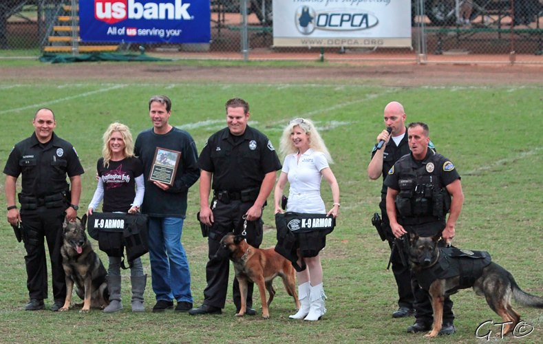 Orange PD Officer Gutierrez with K9 Lycan, Krista and Mike Pennington who generously donated for six vests, Fullerton PD Officer Miller with K9 Mueller, K-9 Armor Co-Founder Suzanne Saunders, OCPCA Pres. Bob Smith and Huntington Beach PD Officer Ricci with K9 Xavi. Photo by Gar Travis of http://www.garphoto.com/
