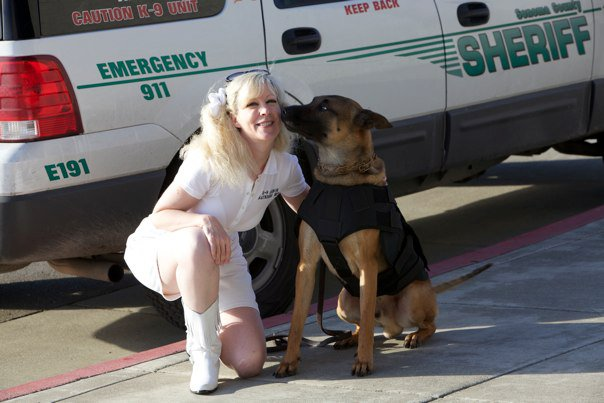 Sonoma County Sheriff K9 Axl gives kisses to Suzanne Saunders, K-9 Armor Co-Founder